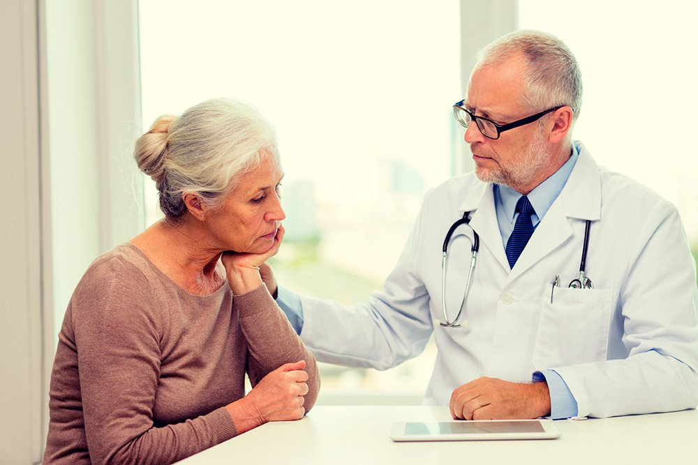 Woman-at-Doctors-Office-with-Doctor