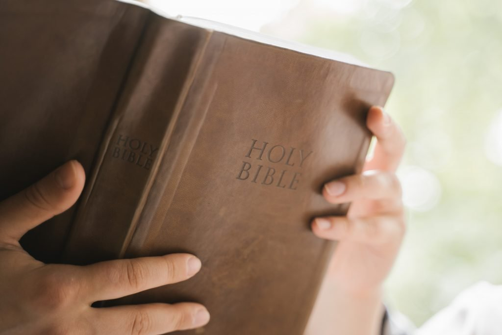 Reading Bible-hands and cover